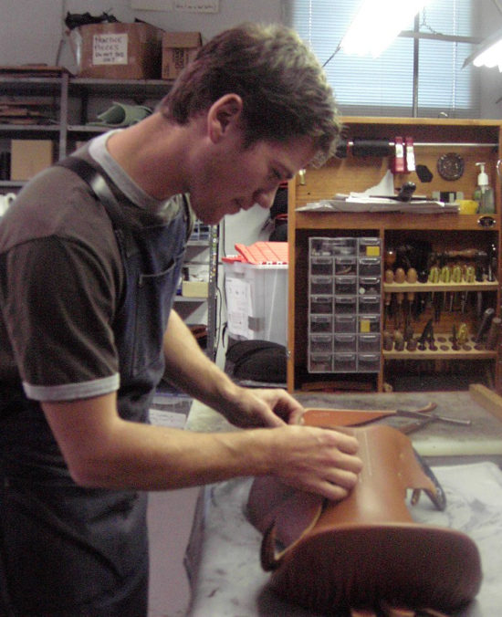 Christ Moloughney shown here setting 'skirts' on a 'blocked' saddle seat during his apprenticeship with Schleese Saddlery.